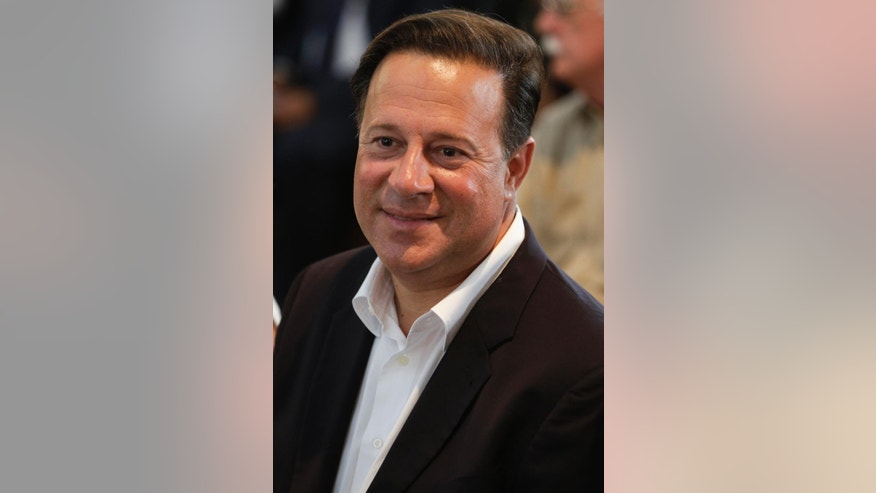 Juan Carlos Varela, presidential candidate for the Panamenista Party, aattends a mass at the Metropolitan Cathedral in Panama City, Saturday, May 3, 2014. Panamanians go to the polls on Sunday to elect a new president from a field of seven and legislators. (AP Photo/Arnulfo Franco)