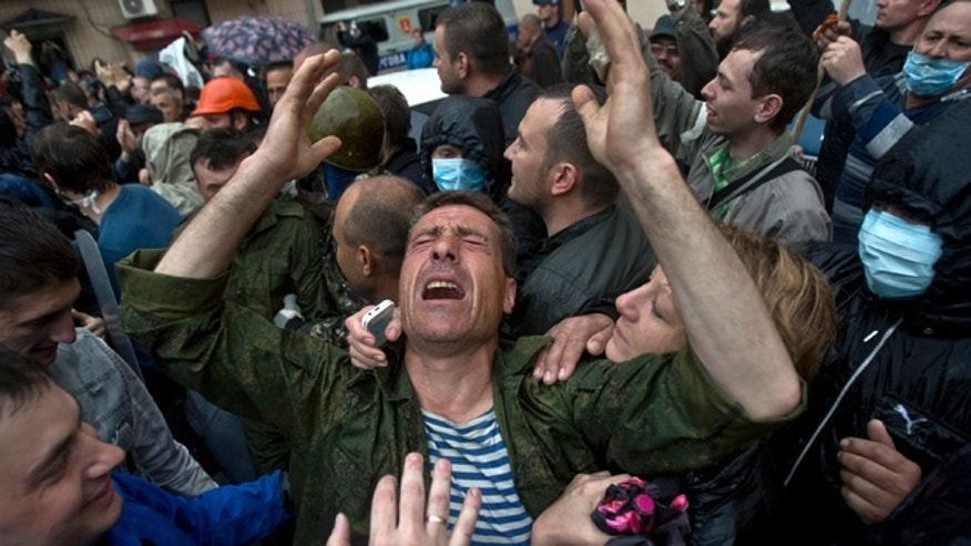 May 4, 2014: A man cries after being released from a local police station which was stormed by pro-Russian protesters in Odessa, Ukraine. Several prisoners that were detained during clashes that erupted Friday between pro-Russians and government supporters in the key port on the Black Sea coast were released under the pressure of protesters that broke into a local police station and received a hero's welcome by crowds.