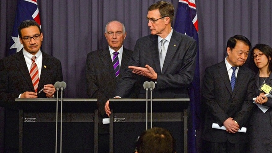 May 5, 2014: Australia's Transport Minister Warren Truss, second from left, Malaysia's acting Transport Minister Hishammuddin Hussein, left, and China's Transport Minister Yang Chuantang, second from right, attend a press conference for the nearly two-month-old hunt for the missing Malaysian jet with search coordinator Angus Houston, center, in Canberra, Australia.