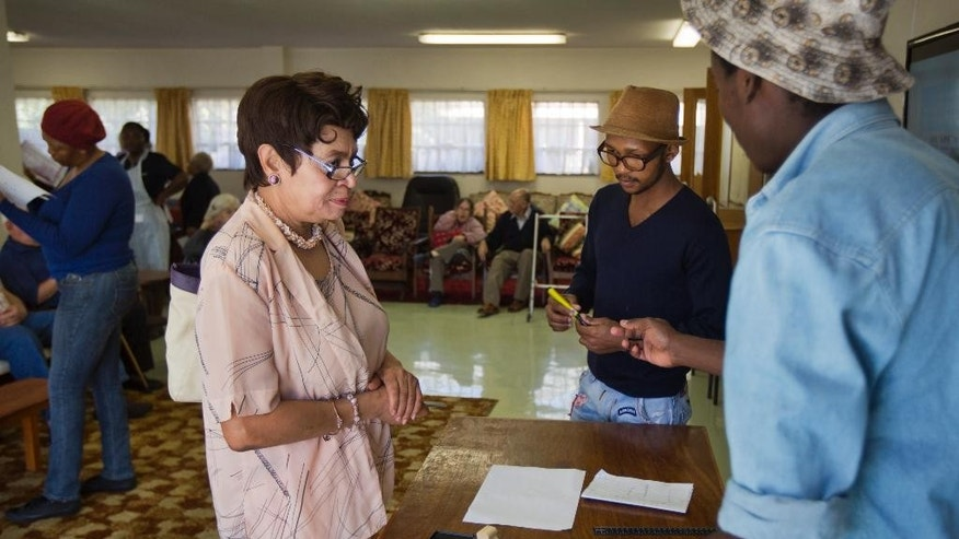 Election workers prepare to give ballot papers to elderly and disabled South African voters to cast their ballots during early voting for special groups at the Nazareth House old-age home in Johannesburg, South Africa Monday, May 5, 2014. South Africa goes to the polls on Wednesday, May 7, 2014 in elections that are likely to see the ruling African National Congress (ANC) party return to power with a smaller majority due to voters disaffected by corruption in government and economic inequality. (AP Photo/Ben Curtis)
