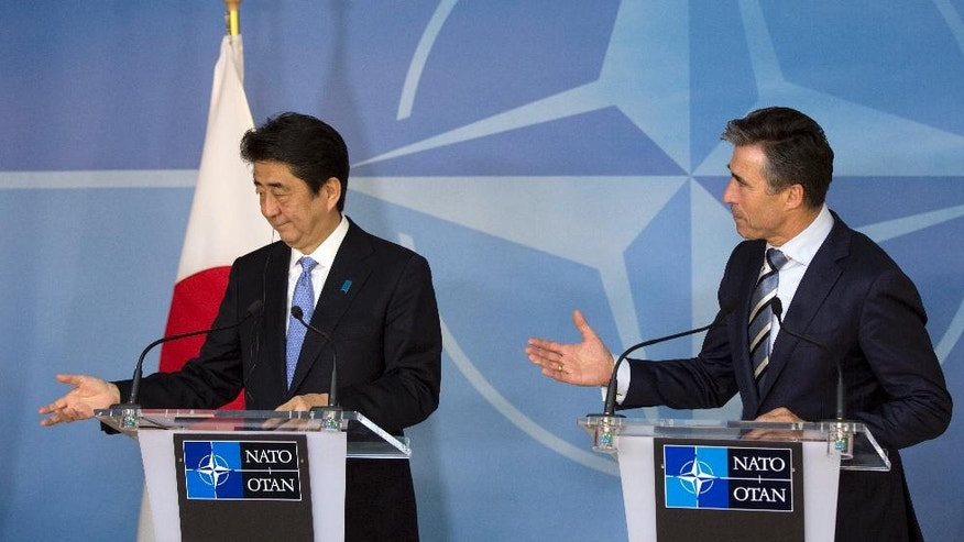 Japan's Prime Minister Shinzo Abe, left, and NATO Secretary General Anders Fogh Rasmussen participate in a media conference at NATO headquarters in Brussels on Tuesday, May 6, 2014. Abe will, in a two-day visit, meet with NATO, EU and Belgian officials. (AP Photo/Virginia Mayo)