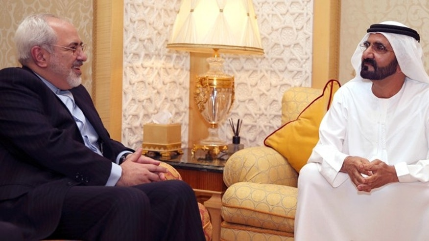 April 15, 2014: In this image released by the Emirates News Agency, WAM, Iranian Foreign Minister Mohamad Javad Zarif, left, meets with Sheikh Mohammed bin Rashid Al Maktoum, UAE Prime Minister and ruler of Dubai to discuss bilateral relations and regional developments, in Dubai, United Arab Emirates.