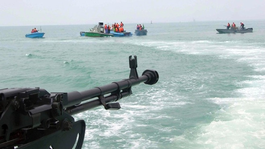 In this file photo taken on April 3, 2006, members of Iran's elite Revolutionary Guard attend  maneuvers in the Persian Gulf.