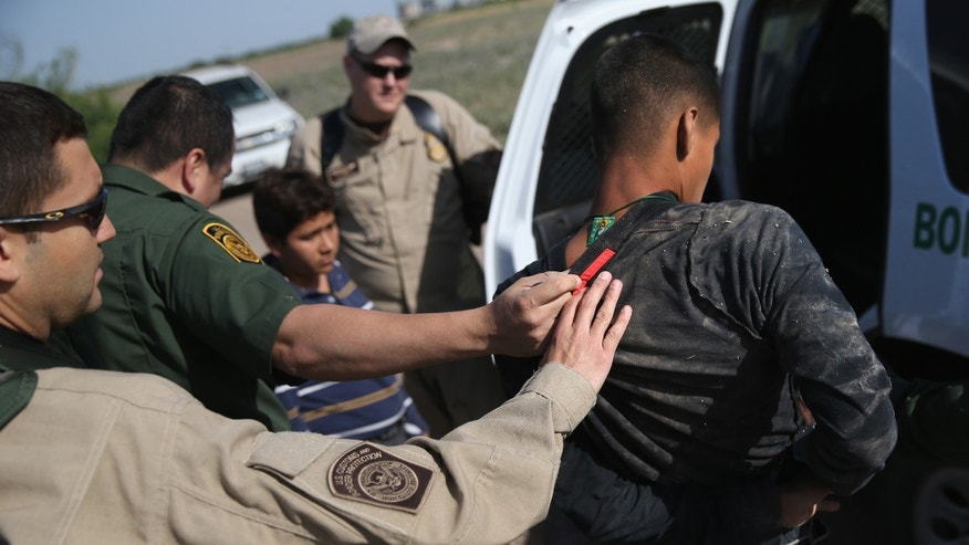 MISSION, TX - APRIL 11:  U.S. Border Patrol and U.S. Air and Marine agents work together to detain an undocumented immigrant after chasing him down near the U.S.-Mexico border on April 11, 2013 near Mission, Texas. A group of 16 immigrants from Mexico and El Salvador said they crossed the Rio Grande River from Mexico into Texas during the morning hours before they were caught. The Rio Grande Valley sector of has seen more than a 50 percent increase in illegal immigrant crossings from last year, according to the Border Patrol. Agents say they have also seen an additional surge in immigrant traffic since immigration reform negotiations began this year in Washington D.C. Proposed refoms could provide a path to citizenship for many of the estimated 11 million undocumented workers living in the United States. Photo by John Moore/Getty Images)  (Photo by John Moore/Getty Images)