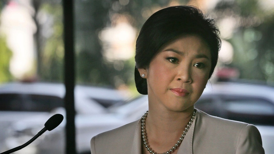 FILE - In this Dec. 10, 2013 file photo, Thailand's Prime Minister Yingluck Shinawatra gets emotional after speaking at a press conference, in Bangkok. (AP Photo/Manish Swarup, File)