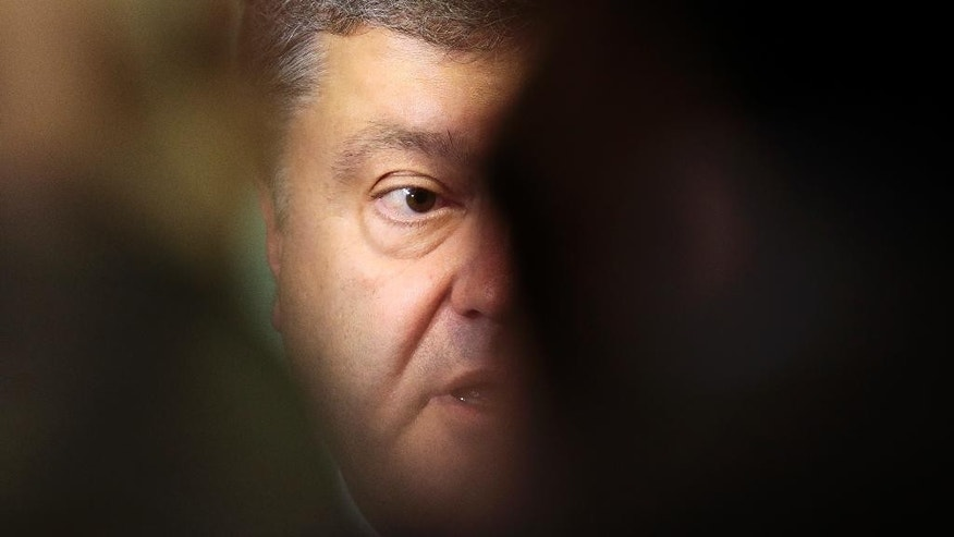 Ukrainian presidential candidate and businessman Petro Poroshenko briefs the media after a meeting with Germany's Christian Union's faction law makers in Berlin, Germany, Wednesday, May 7, 2014. The Ukrainian government is planing a presidential election on May 25, 2014. (AP Photo/Markus Schreiber)
