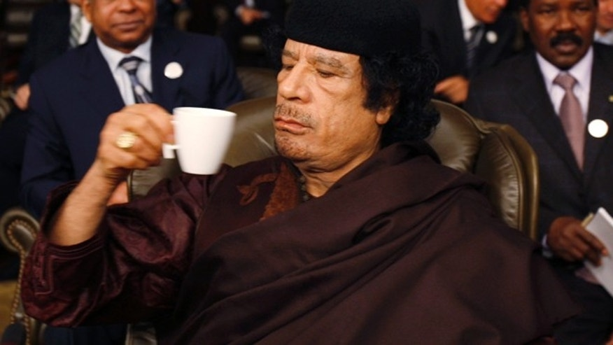 March 29, 2008: Libyan leader Muammar Qaddafi drinks during the opening of the two-day Arab Summit in Damascus