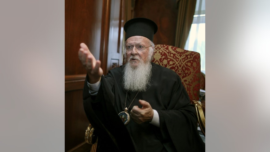 In this Friday, May 2, 2014 photo, Bartholomew I, spiritual leader of 250 million Orthodox Christians, speaks during an interview with The Associated Press in his office in Istanbul. Bartholomew I said a meeting with Pope Francis in Jerusalem this month will help move the two churches closer to ending their nearly one-thousand-year divide. (AP Photo/Emrah Gurel)