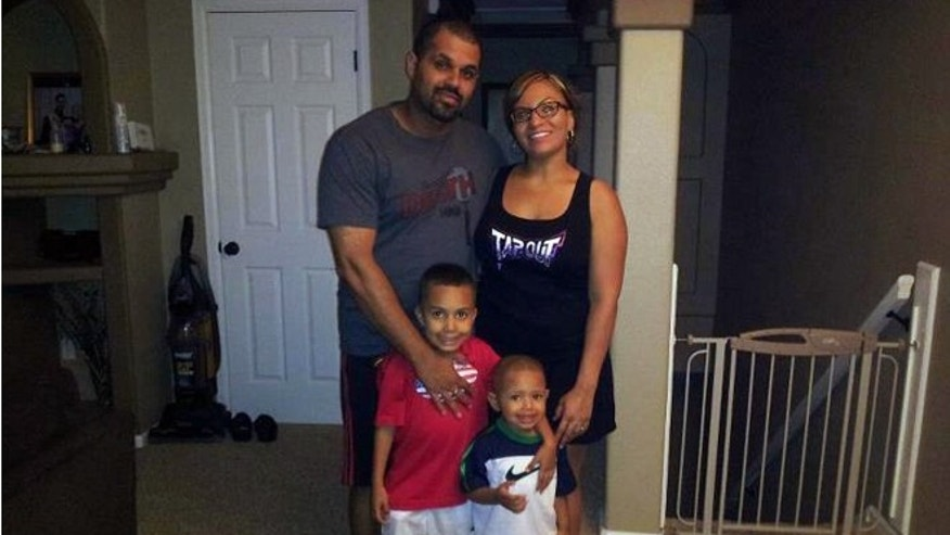 Rene Lima Marin with his wife Jasmine and children Justus, 7, and Josiah, 4, at their home in Aurora, Colo.