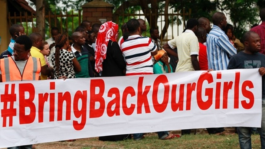 May 10, 2014: People attend a rally calling on the Government to rescue the school girls kidnapped from the Chibok Government secondary school, in Abuja, Nigeria. The president of Nigeria for weeks refused international help to search for more than 300 girls abducted from a school by Islamic extremists, one in a series of missteps that have led to growing international outrage against the government.
