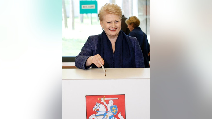 Lithuania's President Dalia Grybauskaite, a presidential candidate, casts her ballot at a polling station during the first round presidential elections in Vilnius, Lithuania, Sunday, May 11, 2014. Grybauskaite is widely expected to win a second term in Lithuania's presidential election. (AP Photo/Mindaugas Kulbis)