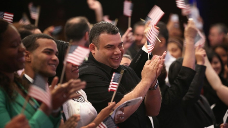 NEW YORK, NY - JULY 26: Newly naturalized American citizens celebrate after taking the Oath of Allegiance to the United States on July 26, 2013 in New York City. Eighty immigrants from 47 countries took part in a naturalization ceremony held at the New York Historical Society. (Photo by John Moore/Getty Images)