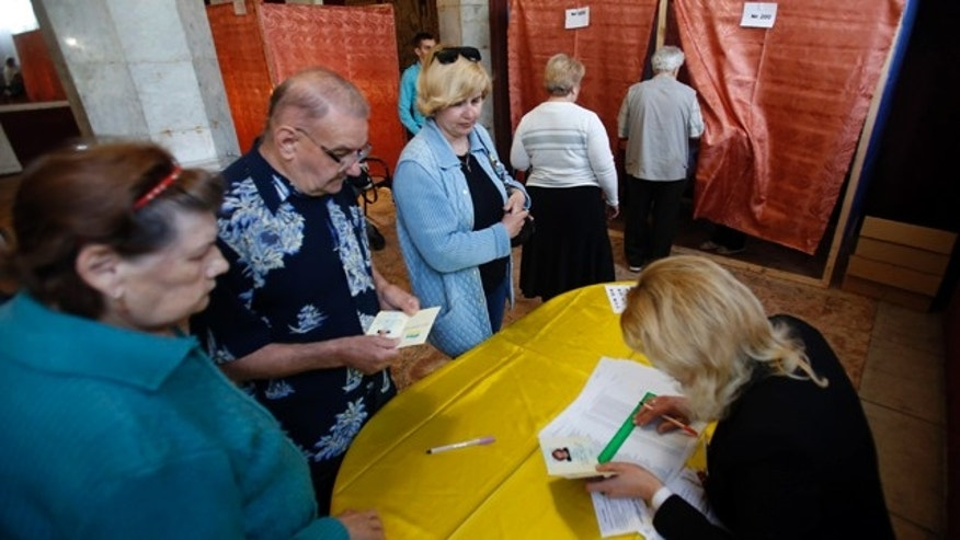 May 11, 2014: People wait in line at a polling station in the center of Slovyansk, eastern Ukraine. (AP Photo/Darko Vojinovic)