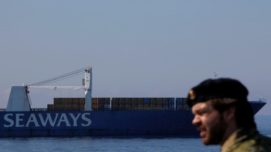 "May 13, 2014: A Danish soldier onboard the Danish warship ""Esbern Snare"" as in the background Danish cargo ship Ark Futura transports Syria's dangerous chemical weapons out of the strife-torn country, out of Cyprus coastal city of Larnaca.  (AP)"