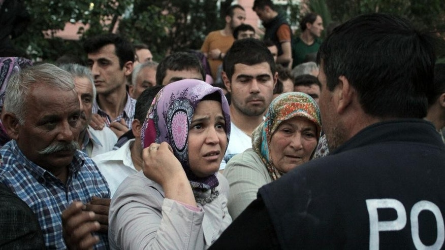 Relatives try to get information outside a local hospital after an explosion and fire at a coal mine in Soma, in western Turkey, Tuesday, May 13, 2014. Officials say that nearly 800 people were in the mine when the accident occurred.  (AP Photo/Depo Photos)