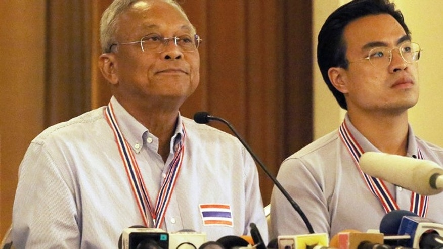 May 13, 2014: Thai anti-government protest leader Suthep Thaugsuban, lef, is flanked by fellow protester Ekkanat Promphant, right, before his announcement at Government House in Bangkok, Thailand.