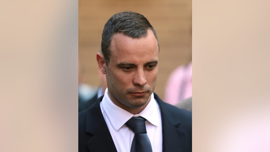 Oscar Pistorius leaves the high court in Pretoria, South Africa, Wednesday, May 14, 2014. The judge overseeing the murder trial of Pistorius on Wednesday ordered the double-amputee athlete to undergo psychiatric tests, meaning that the trial proceedings will be delayed. (AP Photo/Themba Hadebe)