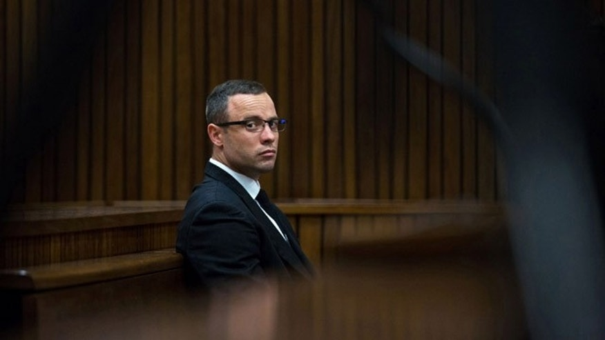 May 13, 2014: Oscar Pistorius listens to psychiatric evidence for his defense during his ongoing murder trial in Pretoria, South Africa. (AP Photo/Daniel Born, Pool)