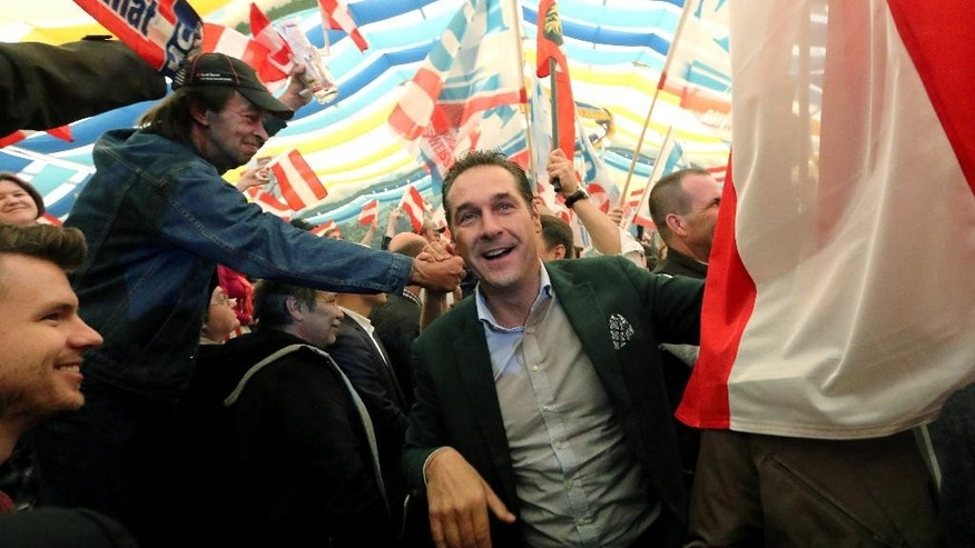 In this picture taken May 1, 2014, Heinz-Christian Strache head of Austria's right-wing Freedom Party, FPOE, arrives for a pre-election party for the European Parliament and for May day celebrations at a beer tent in Linz, Austria. Despite its Eurosceptic stance, the Freedom Party is only a few percentage points behind the Socialists and the conservative People's Party in the May 25 race for EU Parliament seats. And pollsters say that the party would win national elections were they held now, in a stunning upset of the other two establishment parties that have traditionally governed the country. (AP Photo/Ronald Zak)