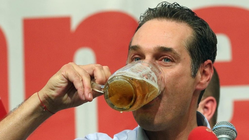 In this picture taken May 1, 2014, Heinz-Christian Strache head of Austria's right-wing Freedom Party, FPOE, drinks a beer during a speech at a pre-election party for the European Parliament and May day celebrations at a beer tent in Linz, Austria. Despite its Eurosceptic stance, the Freedom Party is only a few percentage points behind the Socialists and the conservative People's Party in the May 25 race for EU Parliament seats. And pollsters say that the party would win national elections were they held now, in a stunning upset of the other two establishment parties that have traditionally governed the country. (AP Photo/Ronald Zak)