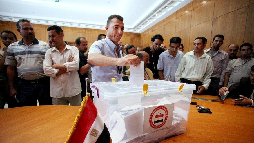 An Egyptian man casts his vote at a polling station, in Amman, Jordan, Thursday, May 15, 2014. Egyptian expatriates around the world headed to the polls on Thursday, casting the first votes to name a successor to deposed Islamist President Mohammed Morsi. (AP Photo/Mohammad Hannon)