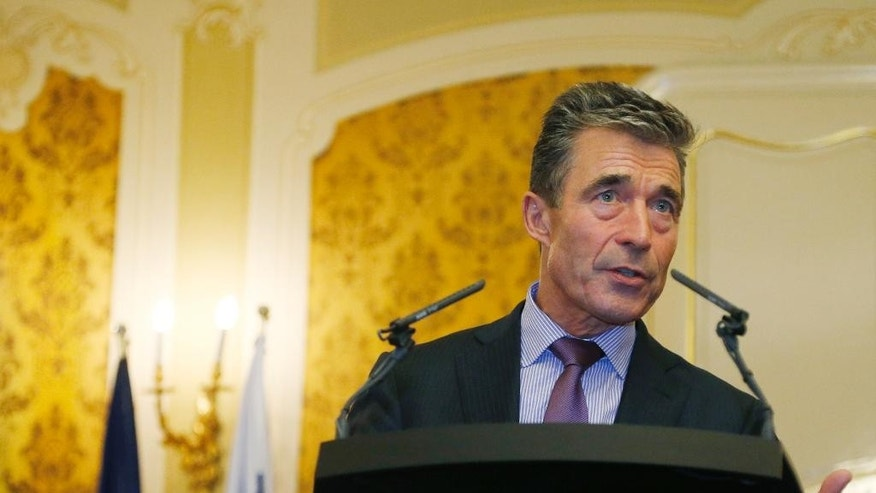 NATO Secretary General Anders Fogh Rasmussen delivers a statement to media after meeting with Slovakia's Prime Minister Robert Fico in Bratislava, Slovakia, Thursday, May 15, 2014. (AP Photo/Petr David Josek)