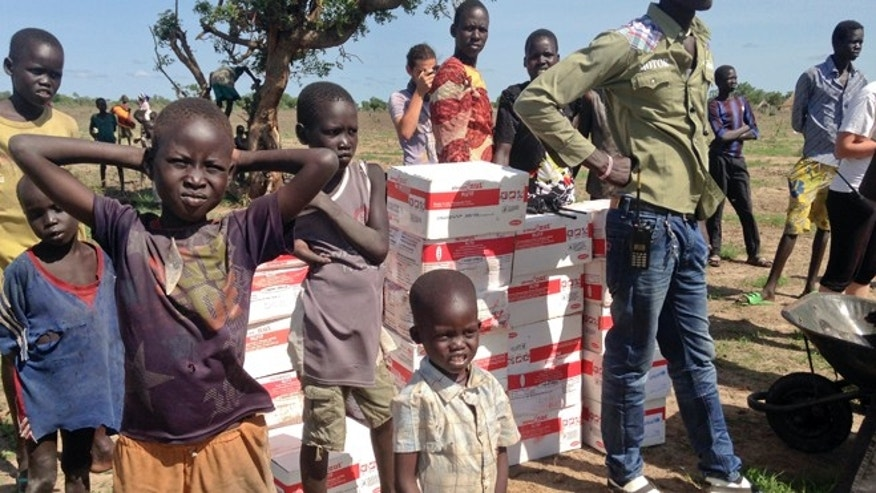 May 7, 2014: Villagers stand by recently-delivered aid from Medecins Sans Frontieres (Doctors Without Borders) in Nyal county, in oil-rich Unity State, South Sudan. (AP)