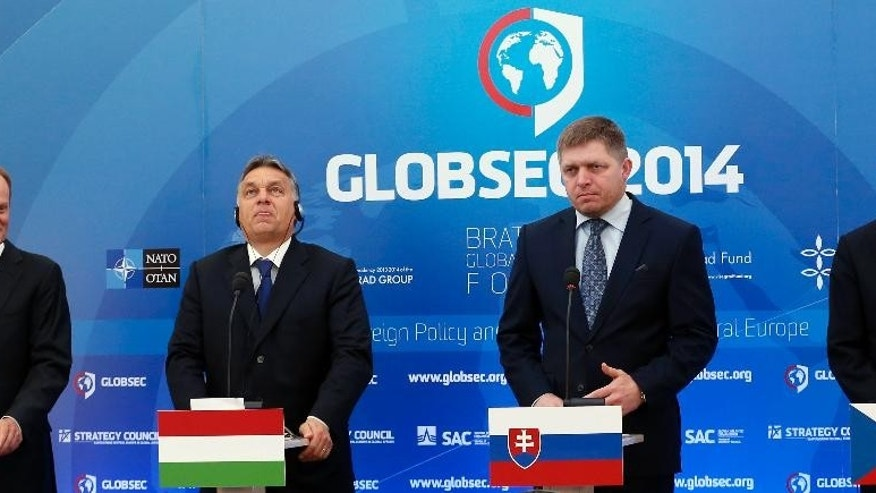 Poland's Prime Minister Donald Tusk, left, Hungary's Prime Minister Viktor Orban, 2nd left, Czech Republic's Prime Minister Bohuslav Sobotka, right, and Slovakia's Prime Minister Robert Fico, 2nd right, address media during a press conference at the Globsec 2014 security forum in Bratislava, Slovakia, Thursday, May 15, 2014. (AP Photo/Petr David Josek)