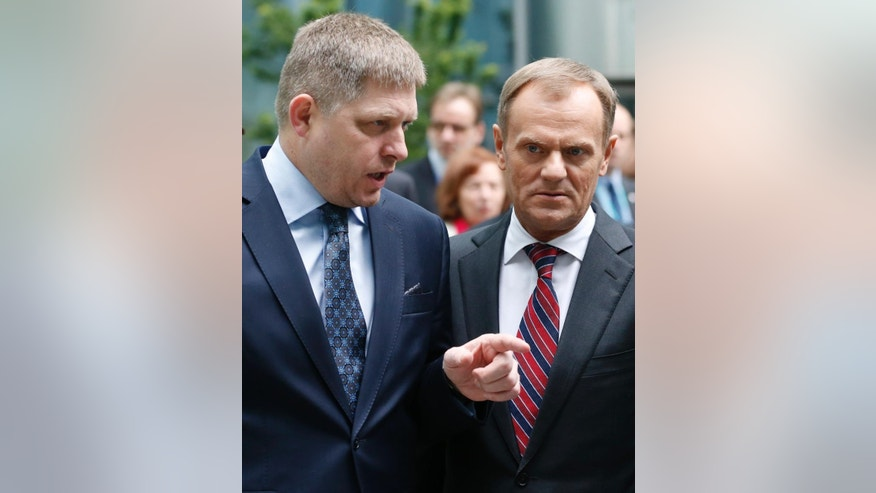 Slovakia's Prime Minister Robert Fico, left, talk to his Poland's counterpart Donald Tusk, right, as they arrive for a press conference at the Globsec 2014 security forum in Bratislava, Slovakia, Thursday, May 15, 2014. (AP Photo/Petr David Josek)
