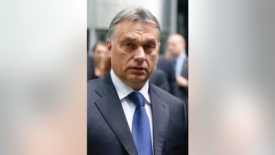 Hungary's Prime Minister Viktor Orban arrives for a press conference at the Globsec 2014 security forum in Bratislava, Slovakia, Thursday, May 15, 2014. (AP Photo/Petr David Josek)