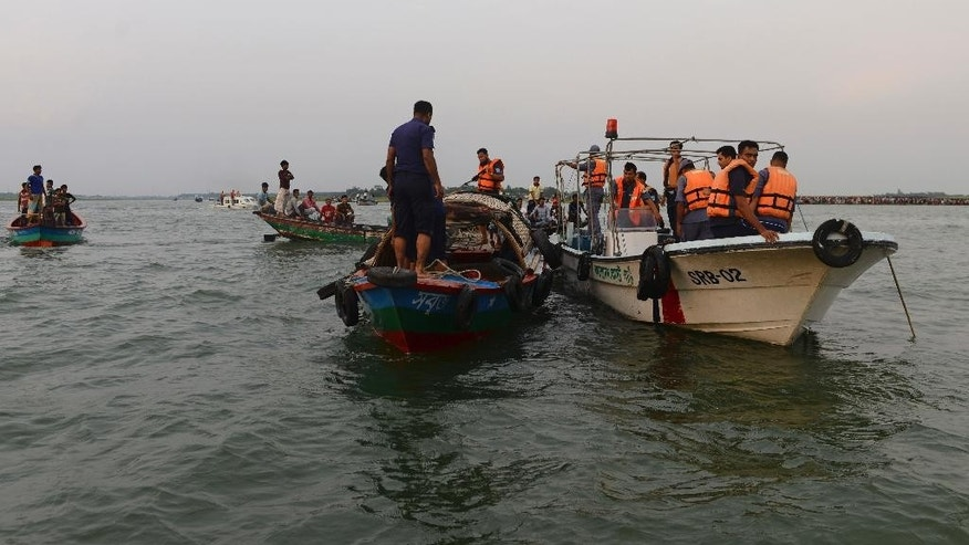 Bangladeshi rescuers look for bodies of victims from the River Meghna after a ferry carrying more than 100 passengers capsized and sank after being hit by a storm in Munshiganj district, Bangladesh, Thursday, May 15, 2014. According to an official eight bodies have been recovered and there was confusion about the number of missing people. (AP Photo/Sony Ramany)