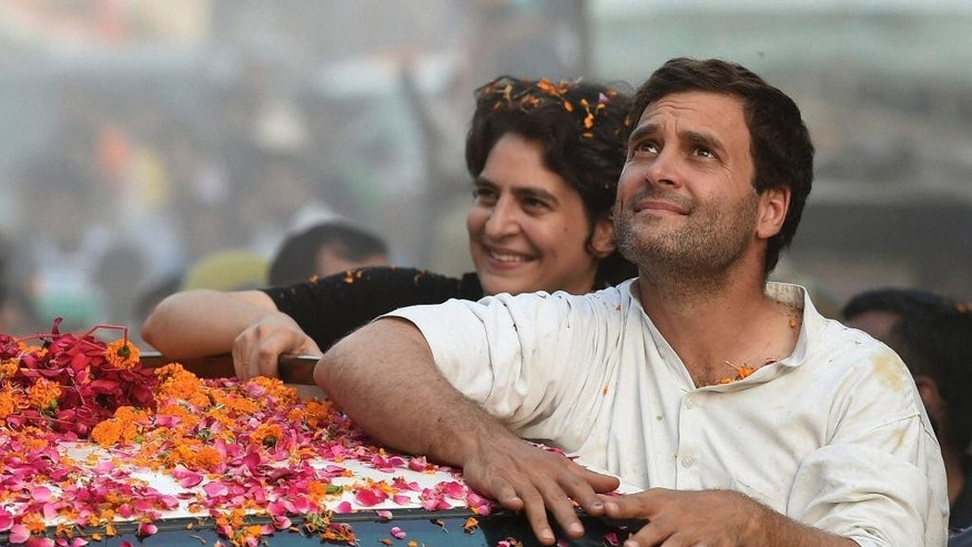 In this Sunday, May 4, 2014 photo, India's Congress party Vice President Rahul Gandhi, front, and his sister Priyanka Vadra campaign in Gandhi's home constituency of Amethi, in the northern Indian state of Uttar Pradesh. In an election campaign led by Rahul Gandhi - the son, grandson, and great-grandson of Indian prime ministers - the Indian National Congress party suffered the most crushing defeat in its 128-year history Friday when the results of India's general election were released. (AP Photo)