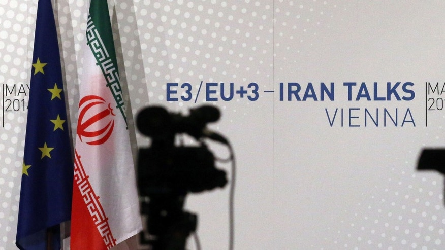 May 16, 2014 - Video cameras stand in front of flags of the EU and Iran and a poster of the Iran talks where closed-door nuclear talks take place at the International Center in Vienna, Austria. Talks between Iran and 6 world powers have entered an ambitious new stage with 2 sides sitting down to start drafting the text of a final deal.