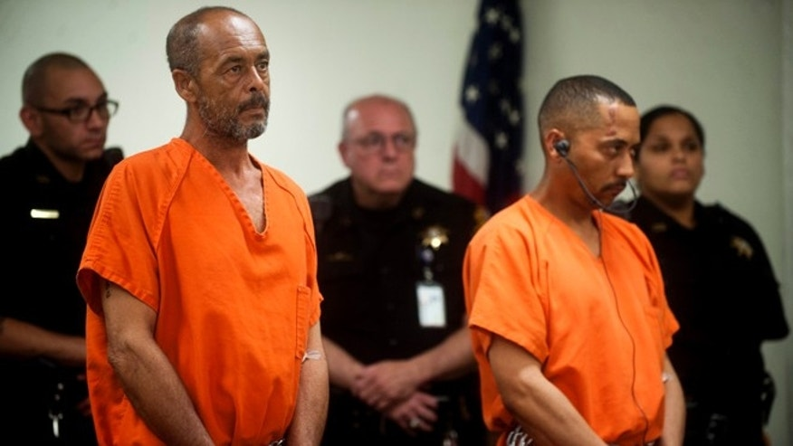 Ramon Ortiz, left, 57, of Pennsauken, and Carlos Alicea-Antonetti, 36, of Camden, are arraigned on murder charges in the slaying of Camden resident Fatima Perez on Thursday, May 15, 2014, at the Hall of Justice in Camden, N.J. Perez, 41, was reported missing on Monday evening and was found Wednesday in Monroe Township, about 20 miles away buried alive in a shallow grave. (AP Photo/Camden Courier-Post, Denise Henhoeffer, Pool)