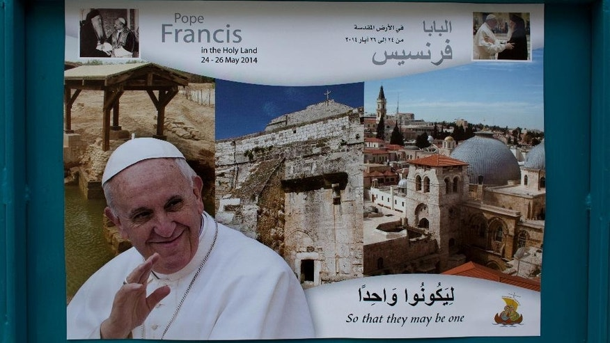 In this Monday, May 12, 2014 photo, a welcome poster with a picture of Pope Francis is posted at a street near the Church of the Nativity, one of the stops of Pope Francis during his upcoming visit in the Holy Land at the end of this month, in the West Bank city of Bethlehem. Israel's internal security agency said it fears there could be more anti-Christian vandalism attacks, and local Vatican officials have urged Israel to safeguard Christian holy sites ahead of the pope's visit at the end of the month. (AP Photo/Nasser Nasser)
