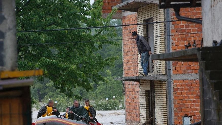 Bosnian Army paddle to rescue a person from a house near Zepce, 120 kms north of Sarajevo, Thursday May 15, 2014. Heavy rainfall caused the river Bosna to flood surrounding areas causing power cuts and road blockades in some suburban and rural areas. (AP Photo/Amel Emric)