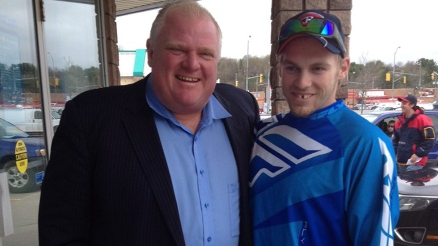 May 16, 2014: In this photo provided by Brody Lisle, Toronto Mayor Rob Ford poses for a photo with him in Bracebridge, Ontario, Canada.