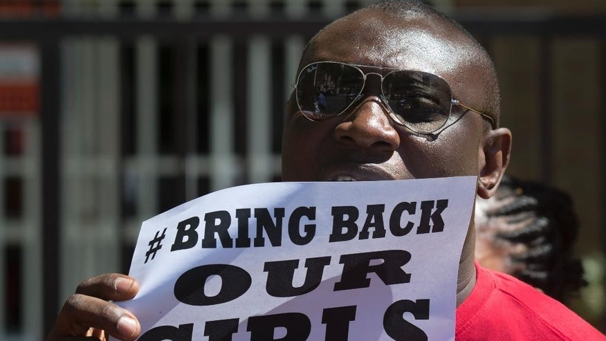 A Nigerian, resident in Spain protests outside the Nigerian embassy in Madrid, Spain, Friday, May 16, 2014 in support of the kidnapped school girls in Abuja, Nigeria. Boko Haram insurgents on April 15 abducted more than 300 students from the Chibok Government Girls Secondary School. Police say 53 managed to escape and 276 remain in captivity. (AP Photo/Paul White)