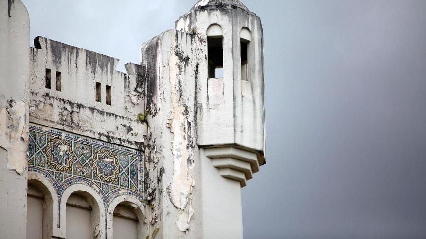 "This May 14, 2014 photo shows a guard tower at the former Rio Piedras State Penitentiary, popularly known as the ""Oso Blanco"" in San Juan, Puerto Rico. The building is considered a magnificent example of Art Deco architecture. It's also part of history, though it's a dark chapter featuring brutality and mismanagement. (AP Photo/Ricardo Arduengo)"