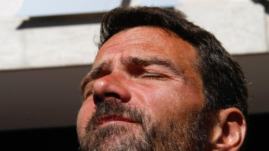 Former trader Jerome Kerviel, closes his eyes during at a press conference in front of his hotel, in Ventimiglia, Italy, near the French border, Sunday, May 18, 2014. The rogue trader facing three years in prison for one of the biggest trading frauds in history is appealing to the French president for mercy. Jerome Kerviel, who almost took down his bank, Societe Generale, with 4.9 billion euros in losses, has been on a months-long pilgrimage back to France after meeting the pope. He stopped his return just short of the border Saturday. Kerviel, convicted in 2010, insists he was the victim of a system that allowed his illegal trades as long as they made money. An appeals court threw out a fine equal to his losses, but upheld his prison sentence. Kerviel is supposed to report to start his sentence by Sunday or be considered a fugitive. (AP Photo/Claude Paris)