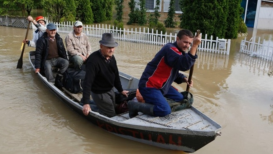 May 18, 2014: Bosnian people are rescued from their flooded houses by boat in the village of Vidovice near Orasje 200 kms north of Sarajevo. Packed into buses, boats and helicopters, carrying nothing but a handful of belongings, tens of thousands fled their homes in Bosnia and Serbia, seeking to escape the worst flooding in a century.