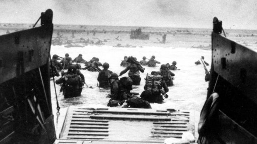 American troops wade ashore during Normandy invasion on D-Day.