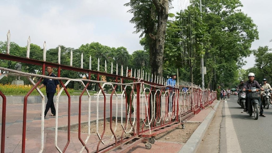 Fences are set up around the V.I.Lenin Park in front of the Chinese Embassy in Hanoi, Vietnam on Sunday, May 18, 2014. Vietnamese authorities forcibly broke up small protests against China in two cities on Sunday, after deadly anti-China rampages over a simmering territorial dispute risked damaging the economy and spooked a state used to keeping a tight grip on its people. In southern Ho Chi Minh City, police dragged away several demonstrators from a park in the city center. In Hanoi, authorities closed off streets and a park close to the Chinese Embassy and pushed journalists and protesters away. (AP Photo/Na Son Nguyen)