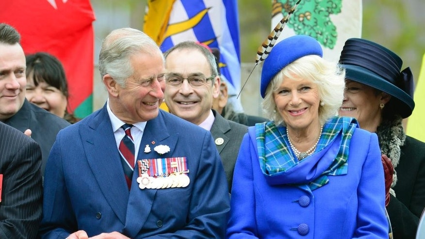Prince Charles and his wife Camilla, the Duchess of Cornwall, smile during an event in Halifax, Nova Scotia on Monday, May 19, 2014.  Prince Charles and Camilla are visiting Nova Scotia, Prince Edward Island and Manitoba. (AP Photo/The Canadian Press, Paul Chiasson)
