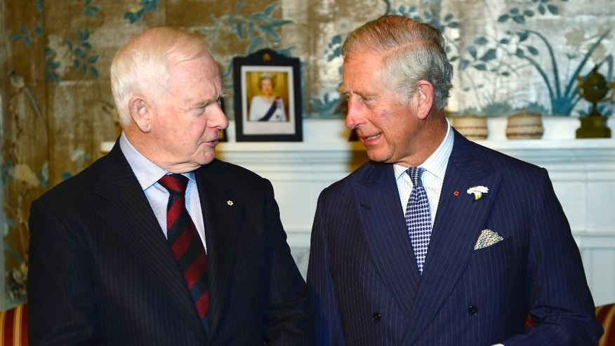 Prince Charles, right, meets the Governor General of Canada David Johnston in Halifax, Canada, on Sunday, May 18, 2014. The royal couple begins a four-day tour of Canada.  (AP Photo/The Canadian Press, Paul Chiasson)