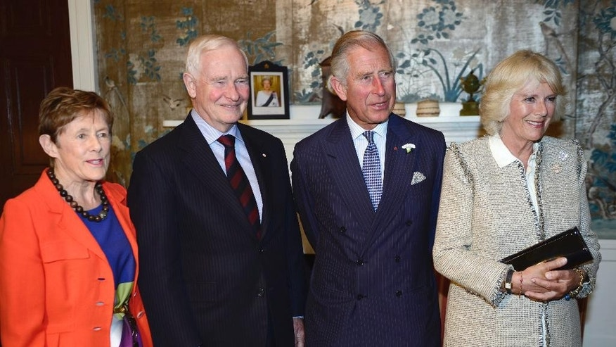 Prince Charles, center right, and his wife Camilla, right, meet the Governor General of Canada, David Johnston and his wife Sharon in Halifax, Canada, on Sunday, May 18, 2014. The royal couple begins a four-day tour of Canada.  (AP Photo/The Canadian Press, Paul Chiasson)