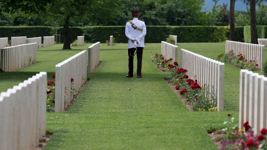 Britain's Prince Harry visits the Cassino's Commonwealth War  Cemetery at the end of a ceremony on the occasion of the 70th anniversary of the WWII's Monte Cassino battle in Cassino, Italy, Monday, May 19, 2014. (AP Photo/Alessandra Tarantino, Pool)