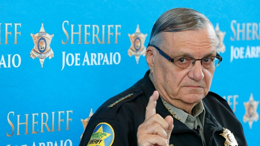 FILE - In this Dec. 18, 2013 file photo, Maricopa County Sheriff Joe Arpaio pauses as he answers a question at a news conference at Maricopa County Sheriff's Office Headquarters, in Phoenix.  A judge presiding over a racial profiling case against Arpaios office is holding a hearing Wednesday, May 7, 2014, to examine whether people working for the agency have read a summary of the cases key findings. (AP Photo/Ross D. Franklin, file)