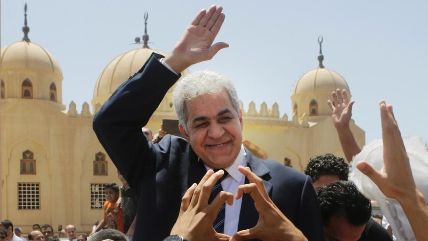 "FILE - In this Friday, May 16, 2014 file photo, presidential hopeful Hamdeen Sabahi greets his supporters after prays Friday prayers at Jerusalem mosque, background, in Baltim city, 212 kilometers (132 miles) north of Cairo, Egypt. The deep underdog in Egypt's presidential elections, candidate Sabahi is trying to rally youth behind him as the hope for the country's pro-democracy ""revolution"" in his race against the former military chief, who some fear will bring back an autocratic rule. (AP Photo/Amr Nabil, File)"