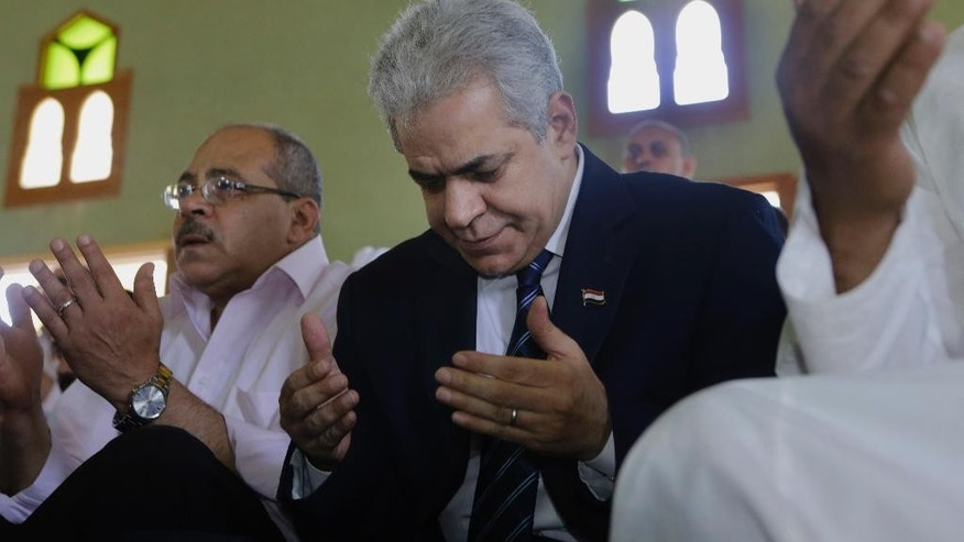 "FILE - In this Friday, May 16, 2014 file photo, Egypt's presidential hopeful Hamdeen Sabahi prays Friday prayers at Jerusalem mosque in Baltim city, 212 kilometers (132 miles) North of Cairo, Egypt. The deep underdog in Egypt's presidential elections, candidate Sabahi is trying to rally youth behind him as the hope for the country's pro-democracy ""revolution"" in his race against the former military chief, who some fear will bring back an autocratic rule. (AP Photo/Amr Nabil, File)"